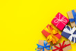 canvas print picture - A lot of gift boxes on a yellow background. Holiday concept, New Year, Christmas, Birthday, Valentine's Day. Flat lay, top view.