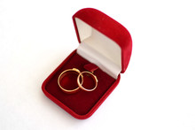 Wedding Ring In A Red Gift Box With A White Background