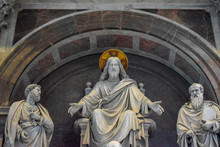 A Sculpture Featuring Jesus, Saint Paul, Saint Peter And A Pope, St. Peter Basilica, Vatican, Italy