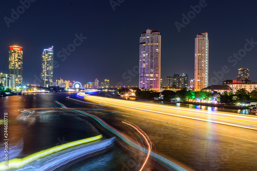 Keuken foto achterwand Nacht snelweg blur light of boat moving at the river of City