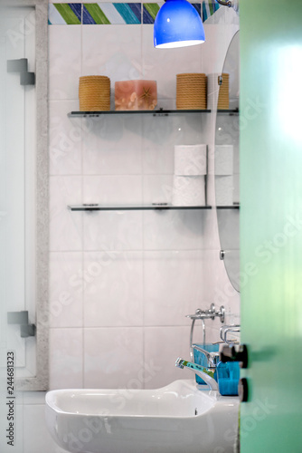 Fotografía  Modern tiled bathroom sink basin faucet paired with blue or turquoise glass soap containers