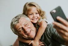 Grandfather Taking A Selfie Wi...