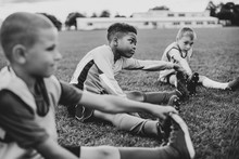 Diverse Kids Stretching On The Field