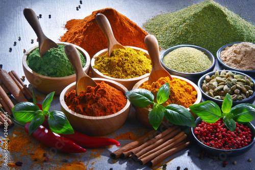 Obraz na plátně  Variety of spices on kitchen table
