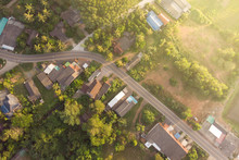 Road And Small Town At Sunrise Aerial View