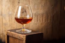 Glass Of Brandy Near A Barrel
