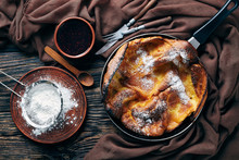 Dutch Baby Pancake Sprinkled With Powdered Sugar