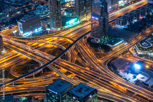 Aerial view of a highway road interchange in Dubai at night, United Arab Emirates