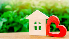 Wooden House And Red Heart. Concept Of Sweet Home. Property Insurance. Family Comfort. Affordable Housing For Young Families. Hotel For Lovers On Valentine's Day.