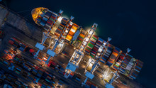 Container Ship In Import Export Business Logistic At Night, Aerial Top View Of Container Ship.