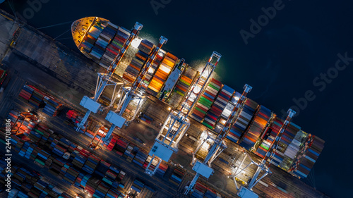 Fotografía  Container ship in import export business logistic at night, Aerial top view of container ship