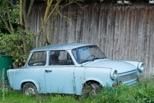 Old Eastern Europe GDR car is in the green meadow Fototapeta