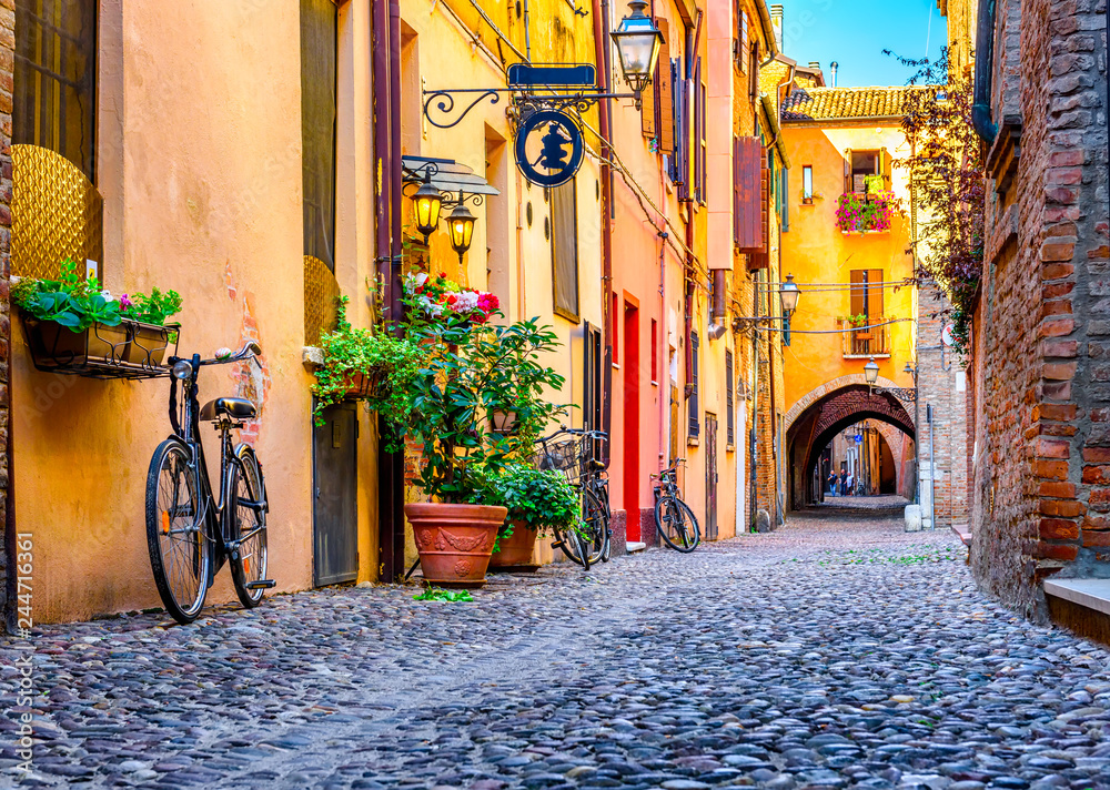 Cozy narrow street in Ferrara, Emilia-Romagna, Italy. Ferrara is capital of the Province of Ferrara