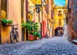 Leinwanddruck Bild Cozy narrow street in Ferrara, Emilia-Romagna, Italy. Ferrara is capital of the Province of Ferrara