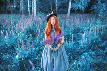 Valentines Day Background. Spring Lupine Flower Garden. Sweet Perfume. Trendy Girl With Red Lips In Dress. Flower Perfume. Redhead Woman On Background Of Lupine Garden. Spring Gardening