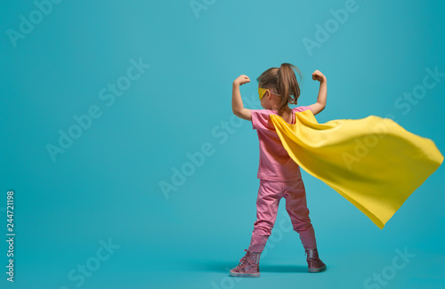Fotomural  child playing superhero