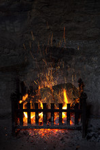 Old Fashioned Open Log Firepla...