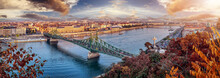Aerial Panorama Of Budapest, Hungary. Sunset Over The City With The Liberty Bridge, The Danube River.