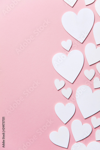 Fotografie, Tablou White hearts on a pastel pink background
