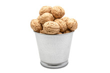 Walnuts In A Tin Bucket On White Background. Wiyh Clipping Path.