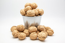 Walnuts In A Tin Bucket On White Background.