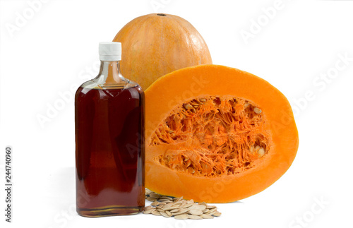 Tuinposter Kruiderij Pumpkin, pumpkin seeds and pumpkin oil in a bottle isolated on a white background..