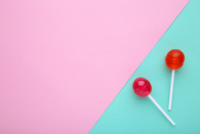 Lollipops On Colorful Background. Sweet Candy Concept