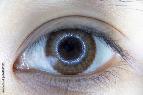 Obraz na plátne Close up of beautiful woman eye and contact lens.
