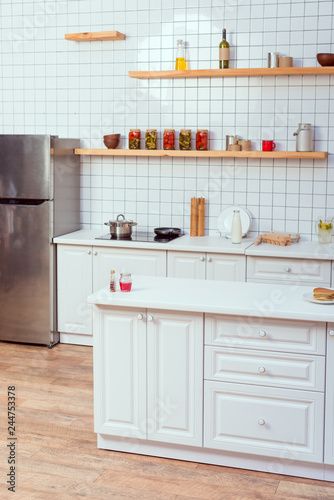 Cadres-photo bureau Cuisine modern kitchen design with white furniture and tile on background