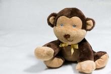 Brown Blue Eyed Monkey Stuffed Animal Plush On White Background