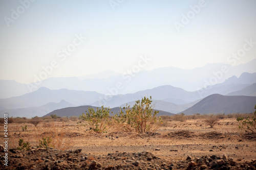 Picturesque road in Tigray region, Ethiopia across a desert with stunning mounta Canvas Print