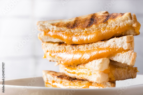 Grilled cheese sandwich on wooden table. Close up