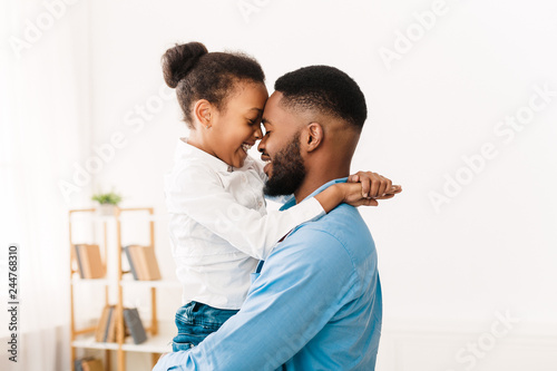 I love you, dad. Man hugging his little cute girl Tableau sur Toile