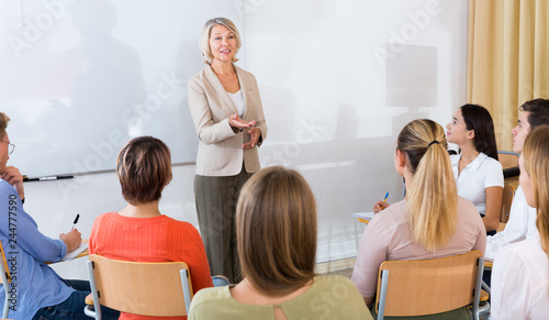 Valokuva Female teacher lecturing to students