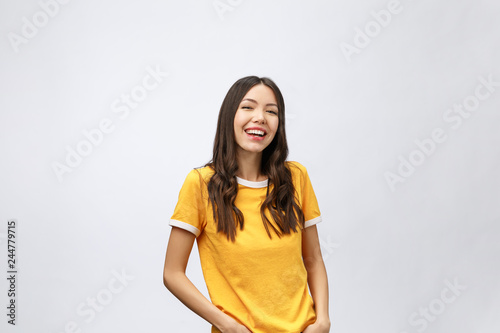 Fotografia  Young friendly Asian woman with smiley face isolated on white background