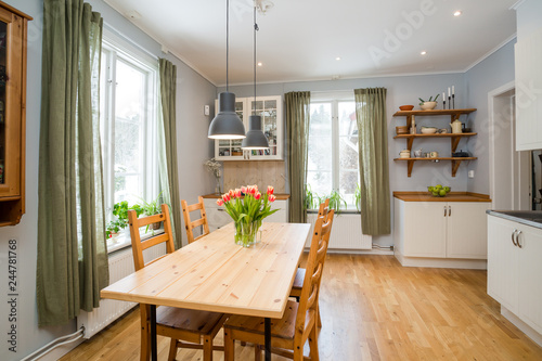 Kitchen Table With Orange Tulips And Green Curtains By The Windows White Interior Wooden Floor Buy This Stock Photo And Explore Similar Images At Adobe Stock Adobe Stock