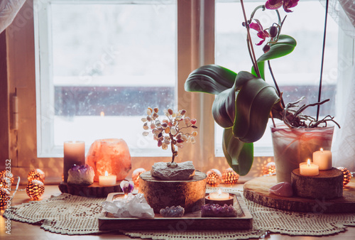 Photo  Feng Shui nature theme altar at home table and on window sill