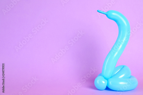 Snake figure made of modelling balloon on color background. Space for text
