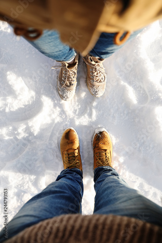 Couple standing on white snow, above view