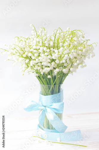 Deurstickers Lelietje van dalen Bouquet of lilies of the valley in a vase. Spring bouquet for your holiday