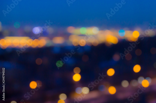 Defocused abstract image. Bokeh effect. Golden lights of the big city. Night city landscape, lights and Windows of houses.