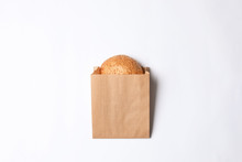 Paper Bag With Sesame Bun On W...