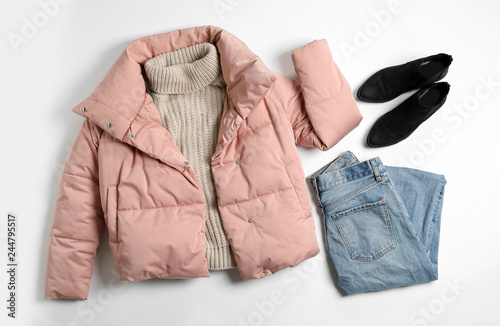 Flat lay composition with female winter clothes on white background