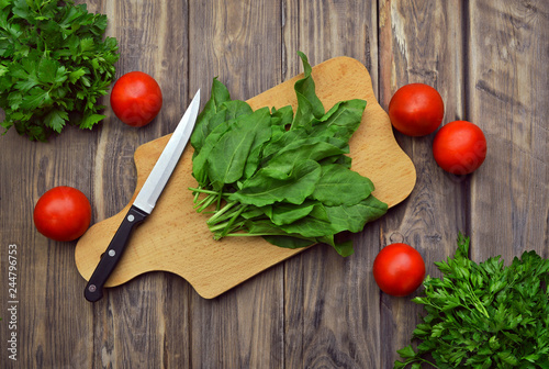 Kitchen background. Cooking. Organic fresh foods for diet, and proper nutrition. Kitchen tools and fresh herbs.