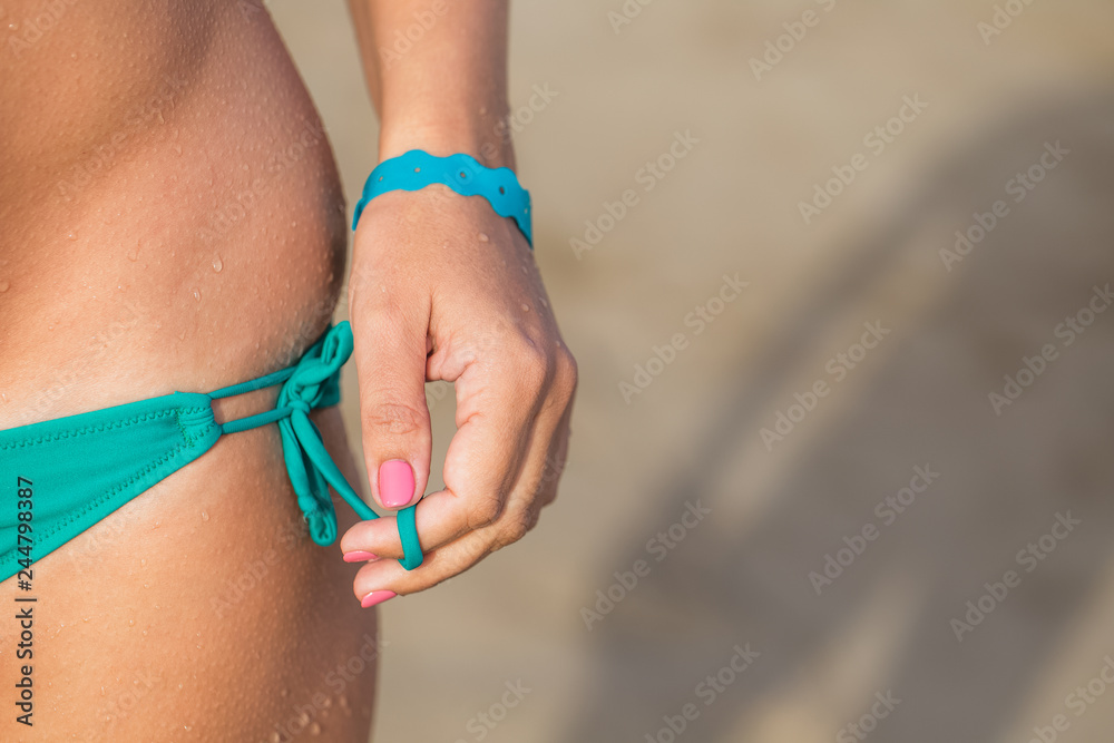 Fototapety, obrazy: Closeup view of wet female body. Woman standing at sandy summer beach of hotel resort. Horizontal color photography.