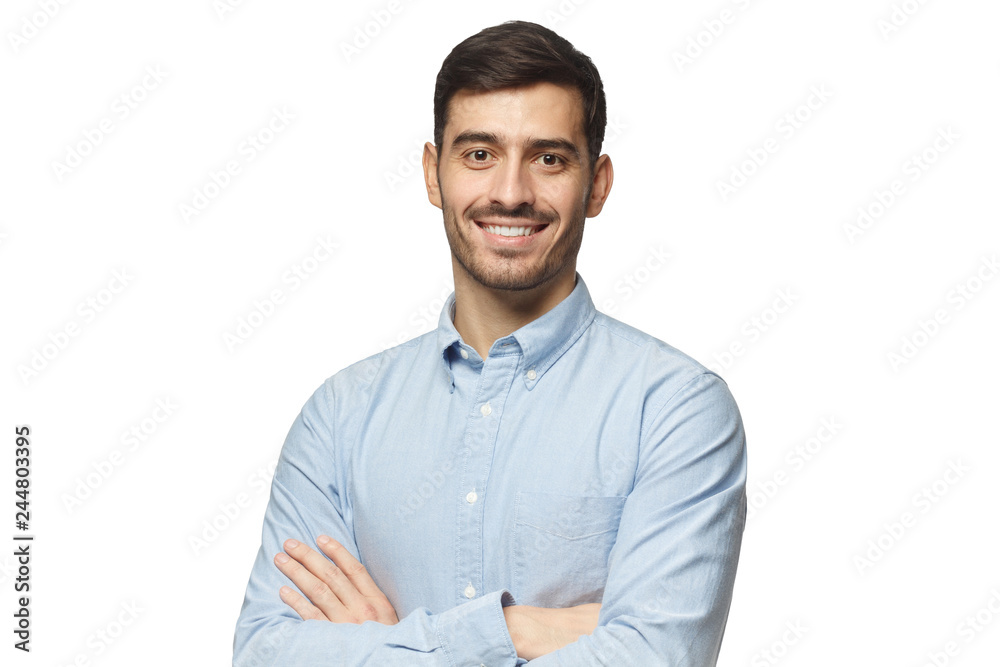 Fototapety, obrazy: Modern businessman in blue shirt standing with crossed arms, isolated on white background