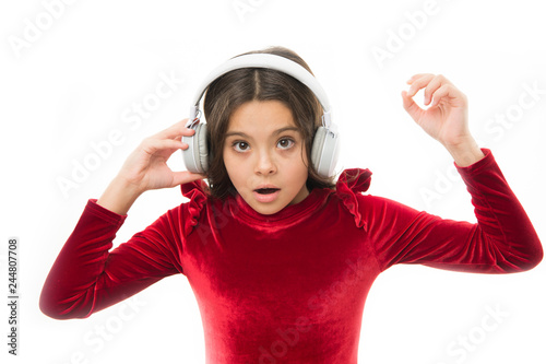 Little girl listen music wireless headphones  Online music channel