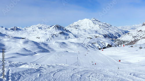 Downhill skiing, snowboarding slopes, off piste trails, in French winter resort of Val d'Isere, Alps , with panorama of mountain snowy peaks and valleys Slika na platnu