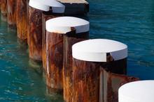 Pier Pilings In Blue Water