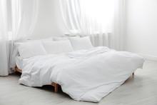 Comfortable Bed In Light Room. Interior Design